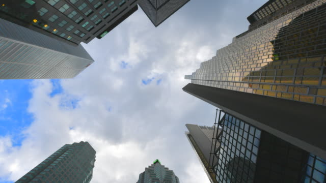 toronto,canada: financial district time lapse of clouds moving over the skyscrapers. low angle view at the royal bank plaza in the canadian city - low angle view stock videos & royalty-free footage