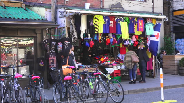 toronto,canada: kensington market everyday lifestyle and routine. bicycle parking space.  the neighborhood in the downtown district is a national historic site of canada - market retail space stock videos and b-roll footage