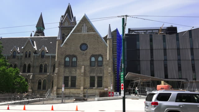 Toronto,Canada: Knox Theological College in Spadina Avenue and everyday lifestyle surrounding it. The historic building belongs to the University of Toronto.