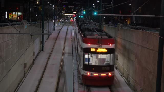 toronto,canada, modern ttc streetcar leaving the spadina subway station at night - tram stock videos & royalty-free footage