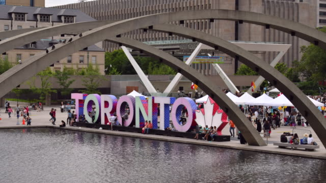 Toronto,Canada: Nathan Phillips Square 3D iconic sign. Time-lapse during a weekend cultural event. Routine lifestyles in the famous place and tourist attraction. Toronto is the capital city of the province of Ontario