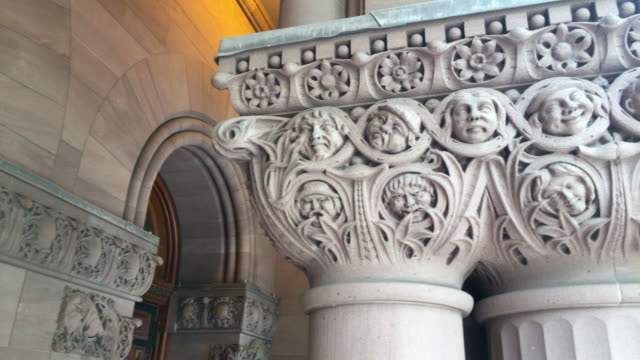 toronto,canada: old city hall, richardsonian romanesque revival architecture detail on columns. the place is a famous tourist attraction in the downtown district of the canadian city capital of the province of ontario - revival stock videos & royalty-free footage