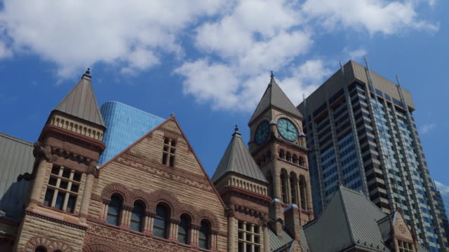 Toronto,Canada: Old City Hall with Richardsonian Romanesque Revival Architecture. Lateral wall tilt, point of view from Nathan Phillips Square. The famous place is a tourist attraction in the Canadian capital city of the province of Ontario