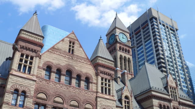 toronto,canada: old city hall with richardsonian romanesque revival architecture. lateral wall tilt, point of view from nathan phillips square. the famous place is a tourist attraction in the canadian capital city of the province of ontario - revival stock videos & royalty-free footage