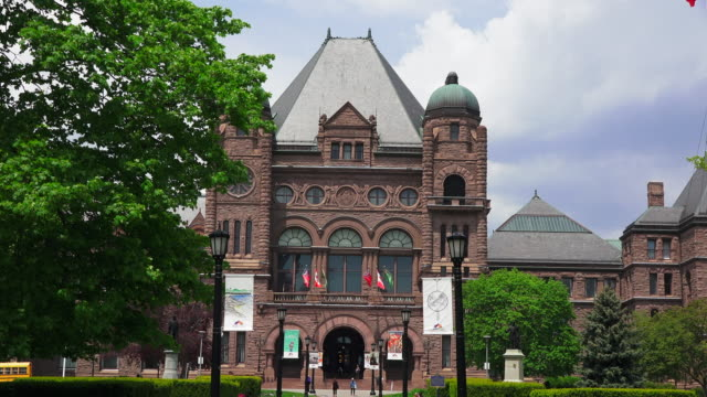 toronto,canada: queen's park romanesque revival building, seat of the ontario provincial government  and major tourist attraction in the canadian city - revival stock videos & royalty-free footage