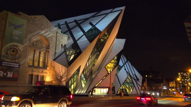 toronto,canada: royal ontario museum (rom) building exterior at night - ontario canada stock videos & royalty-free footage