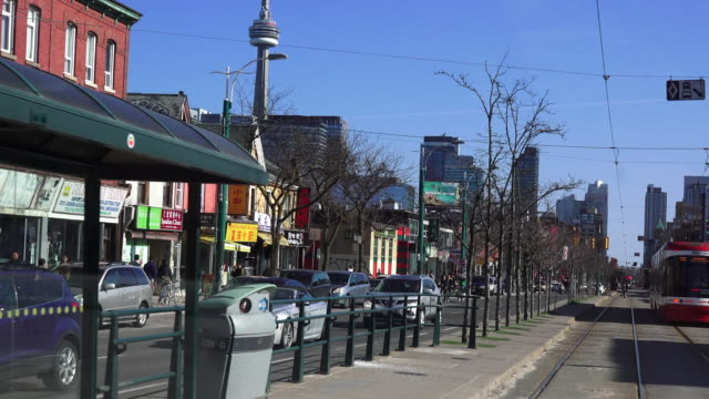 Toronto,Canada: Spadina Street, point of view image from traditional city streetcar. CN Tower in background
