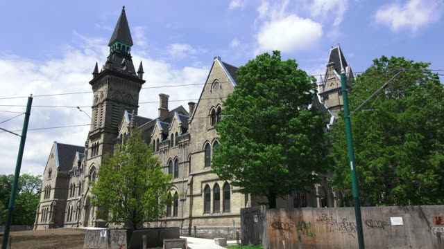 Toronto,Canada: Time Lapse of Knox Theological College in Spadina Avenue and everyday lifestyle surrounding it. The historic building belongs to the University of Toronto.