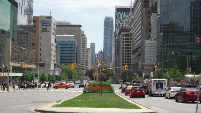 toronto,canada: toronto,canada: time lapse of the downtown and financial district, looking south from queen's park. everyday traffic and lifestyle in the capital city of the ontario province. - toronto stock videos and b-roll footage