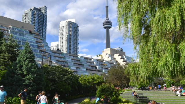 Toronto,Canada: Urban skyline including the CN Tower. Point of view from the Music Garden. Both places are tourists attraction in the Canadian city capital of the province of Ontario