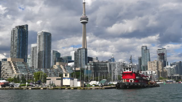 Toronto,Canada: Urban skyline with CN Tower from the shore of Lake Ontario in the city waterfront. The area is a major tourist attraction in the Canadian city and capital of the province of Ontario