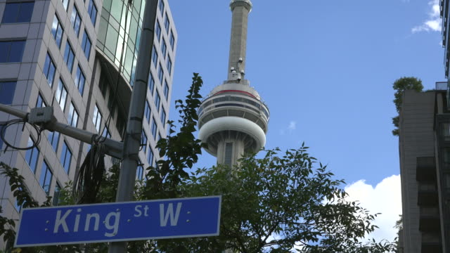 Toronto,Canada: Zoom out from the CN Tower to the King Street West sign in the downtown district