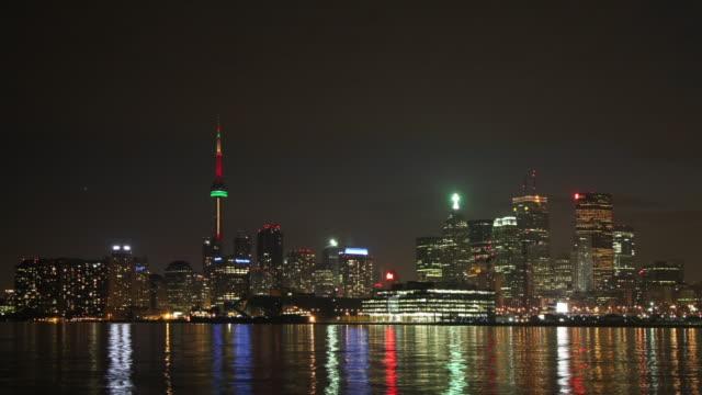 Toronto's colorful skyline reflects on Lake Ontario.