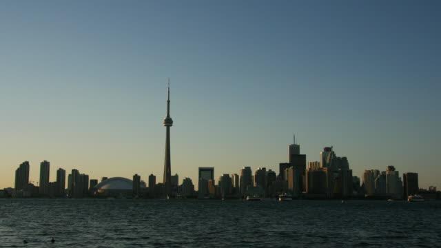 Toronto's distinctive skyline towers above Lake Ontario.