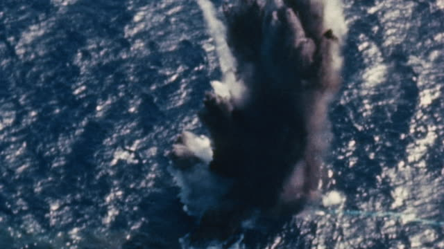 torpedo slamming into target and huge explosion, obscuring target - pacific war stock videos & royalty-free footage
