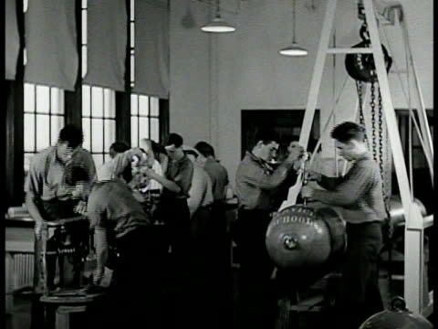 torpedoman rating badge. int torpedomen in training in workshop classroom. vs men working on torpedo shell & parts. wwii world war ii - torpedo stock videos & royalty-free footage