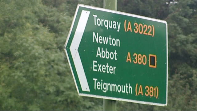 Torquay car crash mother loses two year old son and unborn baby ENGLAND Devon Torquay Close Shot of 'Police Road Closed' sign TILT UP to empty road...