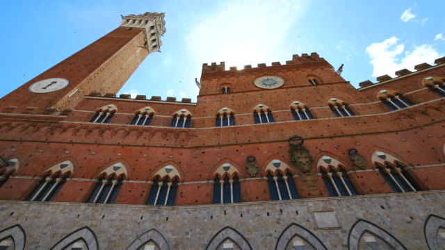 torre del mangia and palazzo pubblico in siena, tuscany, italy - piazza del campo stock videos and b-roll footage