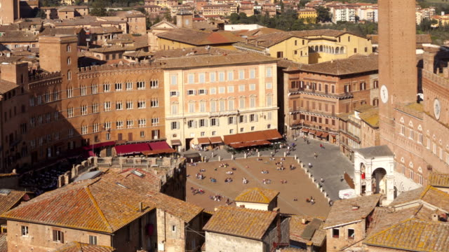 torre del mangia and piazza del campo in siena, italy. - torre del mangia stock videos and b-roll footage