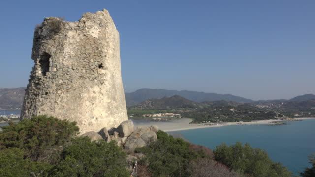 pan / torre di porto giunco at villasimius beach - spiaggia stock videos & royalty-free footage