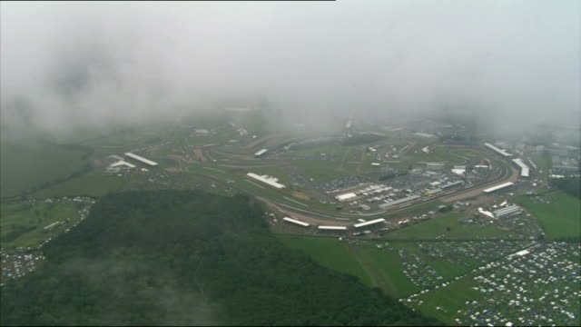 torrential rain and floods across england and wales; england: northamptonshire: silverstone: ext air view / aerial of silverstone race course,... - northamptonshire stock-videos und b-roll-filmmaterial