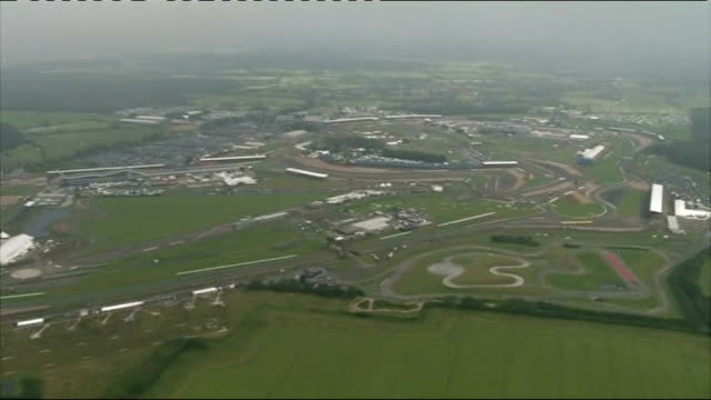torrential rain and floods across england and wales; northamptonshire: silverstone: air view / aerial of silverstone f1 racing track / spectators... - northamptonshire stock-videos und b-roll-filmmaterial