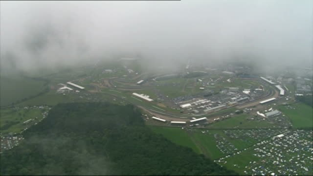 torrential rain and floods across england and wales; northhamptonshire: silverstone circuit: air view silverstone circuit - obscured by cloud air... - silverstone stock videos & royalty-free footage