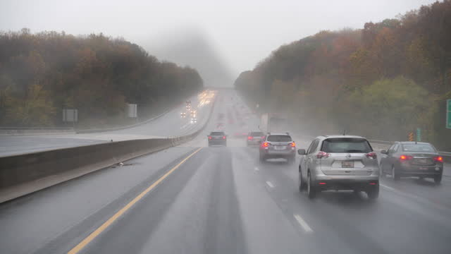 torrential rain and highway traffic - tail light stock videos & royalty-free footage