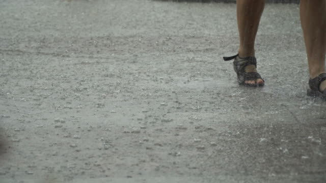 torrential rain and running people - overcast stock videos & royalty-free footage