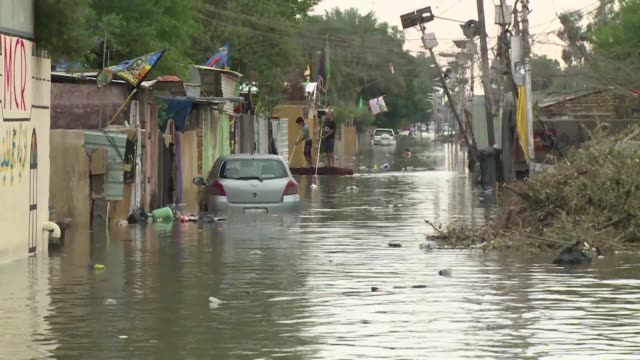 torrential rain caused chaos across several parts of iraq on thursday with the water causing thigh high flooding on some baghdad streets and damaging... - human limb stock videos & royalty-free footage