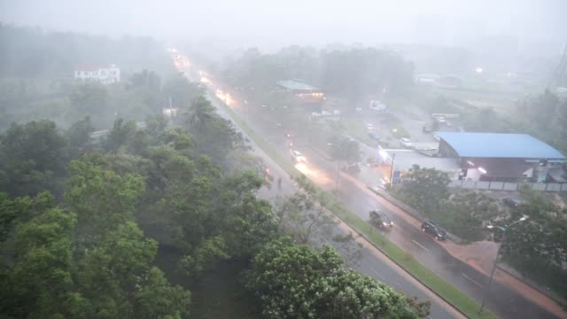 torrential rain due to cyclone gaja in kochi, india - cyclone stock videos and b-roll footage