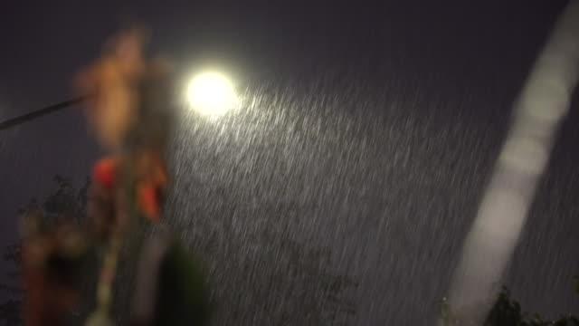 torrential rain falling past street lights - scott mcpartland stock videos & royalty-free footage