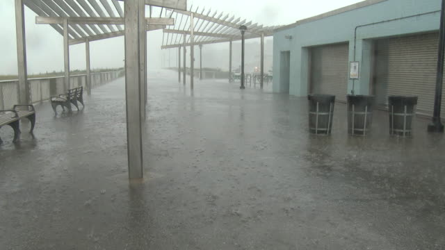 torrential rain falls as one of the outer bands of tropical storm isaias overtakes rockaway beach queens new york new york - scott mcpartland stock videos & royalty-free footage