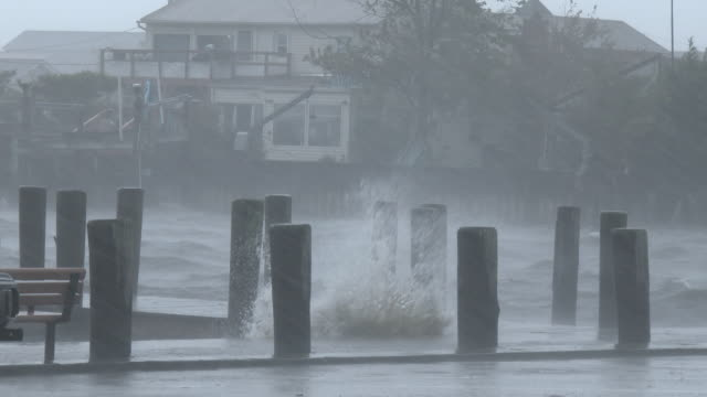 Torrential rain falls as waves crash over a dock at a marina in Suffolk County Long Island during a powerful nor'easter