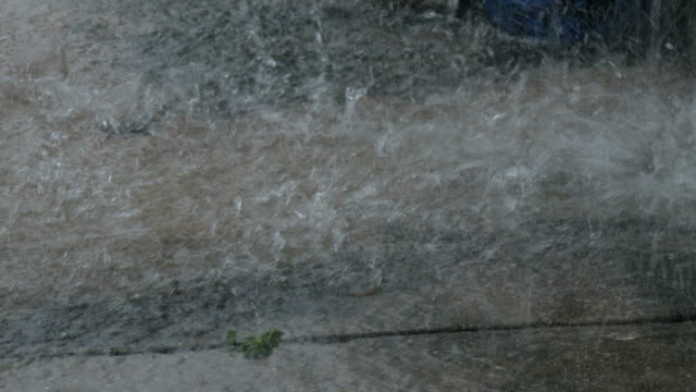Torrential rain on a pavement