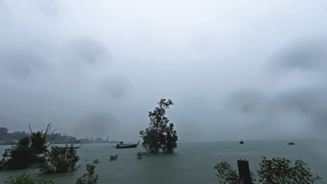 torrential rain storm approaching timelapse - andaman sea stock videos & royalty-free footage