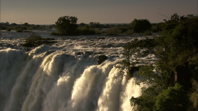 torrents of water flow down victoria falls. - victoria falls stock videos and b-roll footage