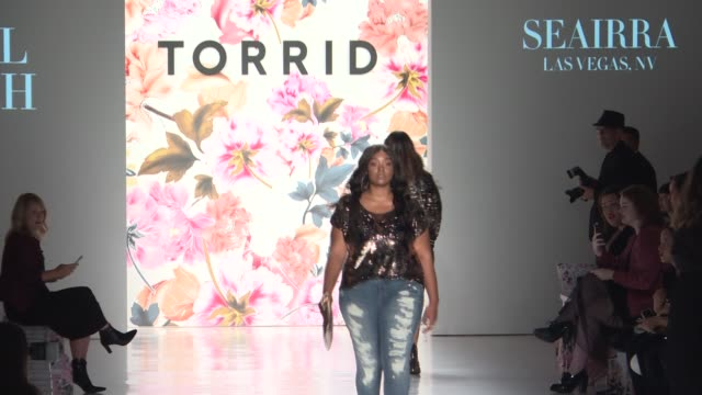 large sized gorgeous women walk the runway for torrid's first fashion show the average american woman wears a size 1618 but the average fashion model... - アトモスフィア点の映像素材/bロール