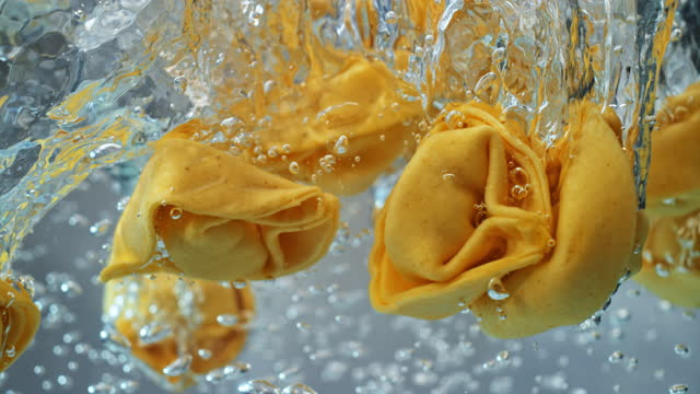 slo mo ld tortellini falling into boiling water - freshness stock videos & royalty-free footage