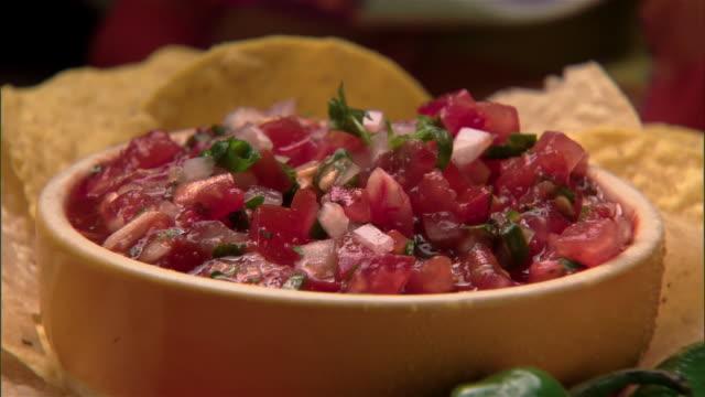 ecu, zo, tortilla chips and salsa sauce  - salsa stock videos & royalty-free footage