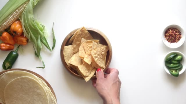tortilla chips with guacemole and salsa verde. - dipping stock videos & royalty-free footage