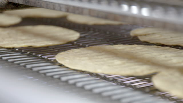 tortilla factory - tortilla flatbread stock videos & royalty-free footage
