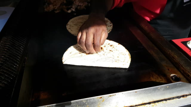 tortillas being prepared on food market - tortilla flatbread stock videos & royalty-free footage
