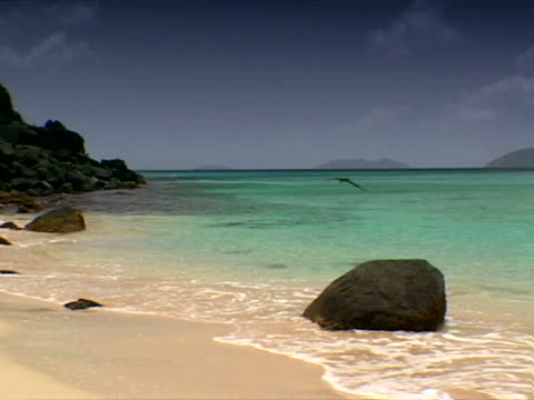 tortola: waves around boulder at apple bay - artbeats stock videos & royalty-free footage