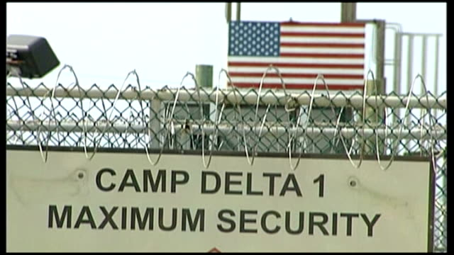 theresa may says she did not request any redactions; lib cuba: guantanamo bay naval base: camp delta ext american flag flying above barbed wire... - torture stock videos & royalty-free footage