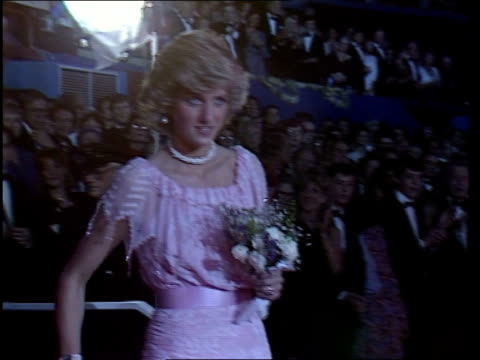 stockvideo's en b-roll-footage met torvill dean video ob england london wembley ms diana onto ice lr with duchess of norfolk as torvill dean skate towards them in 'bolero' outfits ms... - prinses