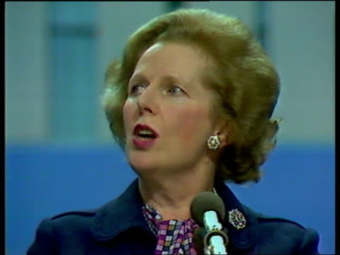 Brighton MS Mrs Thatcher walking along platform to standing ovation CS Mrs Thatcher smiling as given standing ovation THATCHER speaking from top...