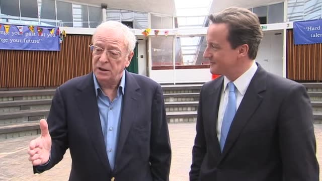 vídeos de stock e filmes b-roll de tory leader david cameron beside actor michael caine as he endorces his support for the conservative following his appearance at their party... - michael caine ator