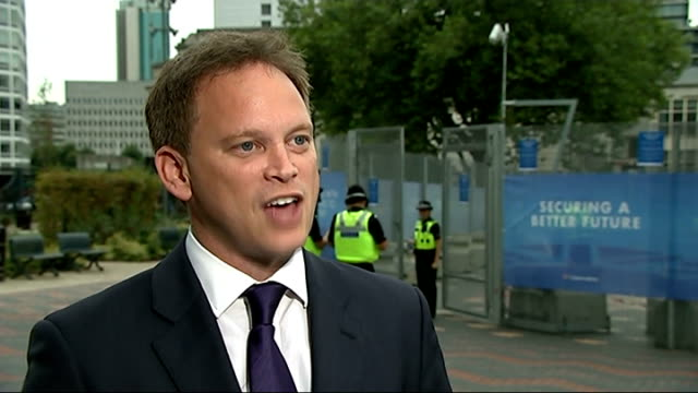 tory mp mark reckless defects to ukip on eve of conservative party conference west midlands birmingham ext police officers outside the icc birmingham... - security screen stock videos & royalty-free footage