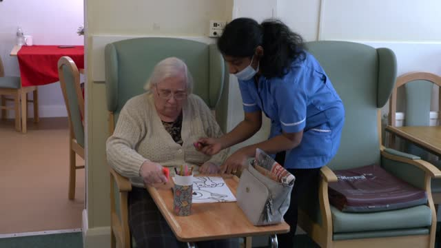 tory mps warn prime minister against increasing national insurance; england: london: watford: int nursing staff helping care home resident with... - drawing activity stock videos & royalty-free footage